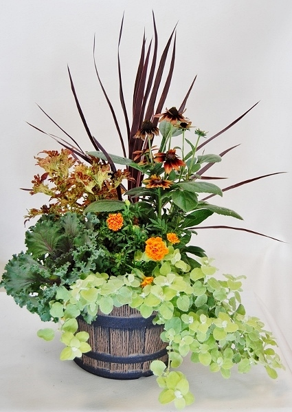 Fall Planter with annuals like kale, echinacea, grasses