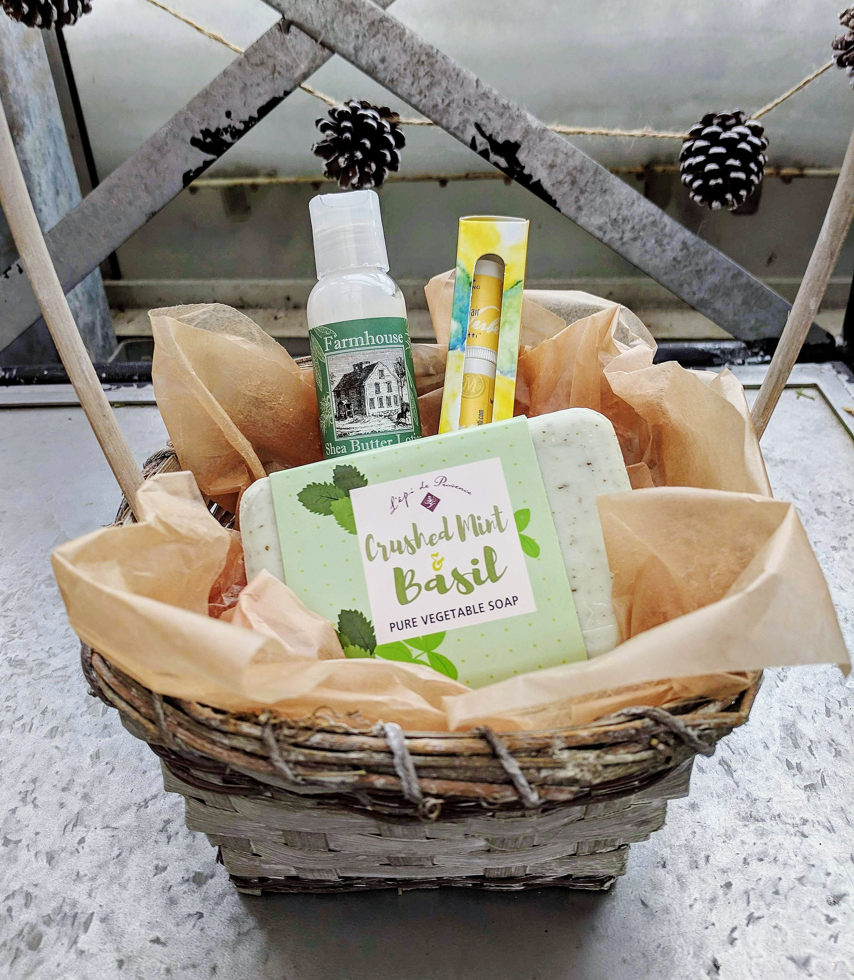body care items like lotion, soap, lip care in a basket