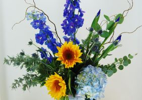 blue and yellow flower centerpiece