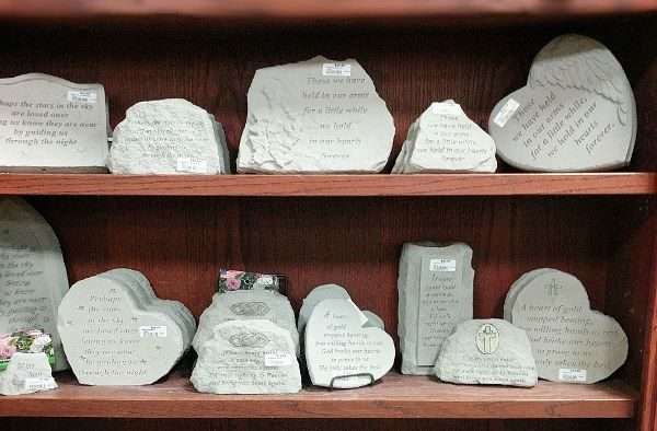 memorial stones with remembrance sayings on them