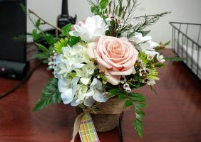 administrative day flowers on desk