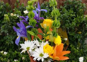 daisies, roses, lillies in a bouquet
