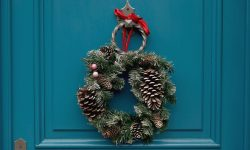 wreath with pines and red ribbon to show decorating front door
