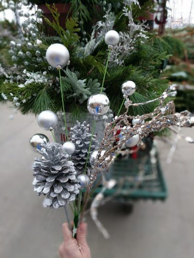 Glittery pine cones, silver gloves, and glittery vines for your evergreen arrangements