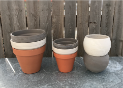 terra cotta pottery in red brown, white, and greay