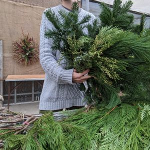 holding evergreen bundles