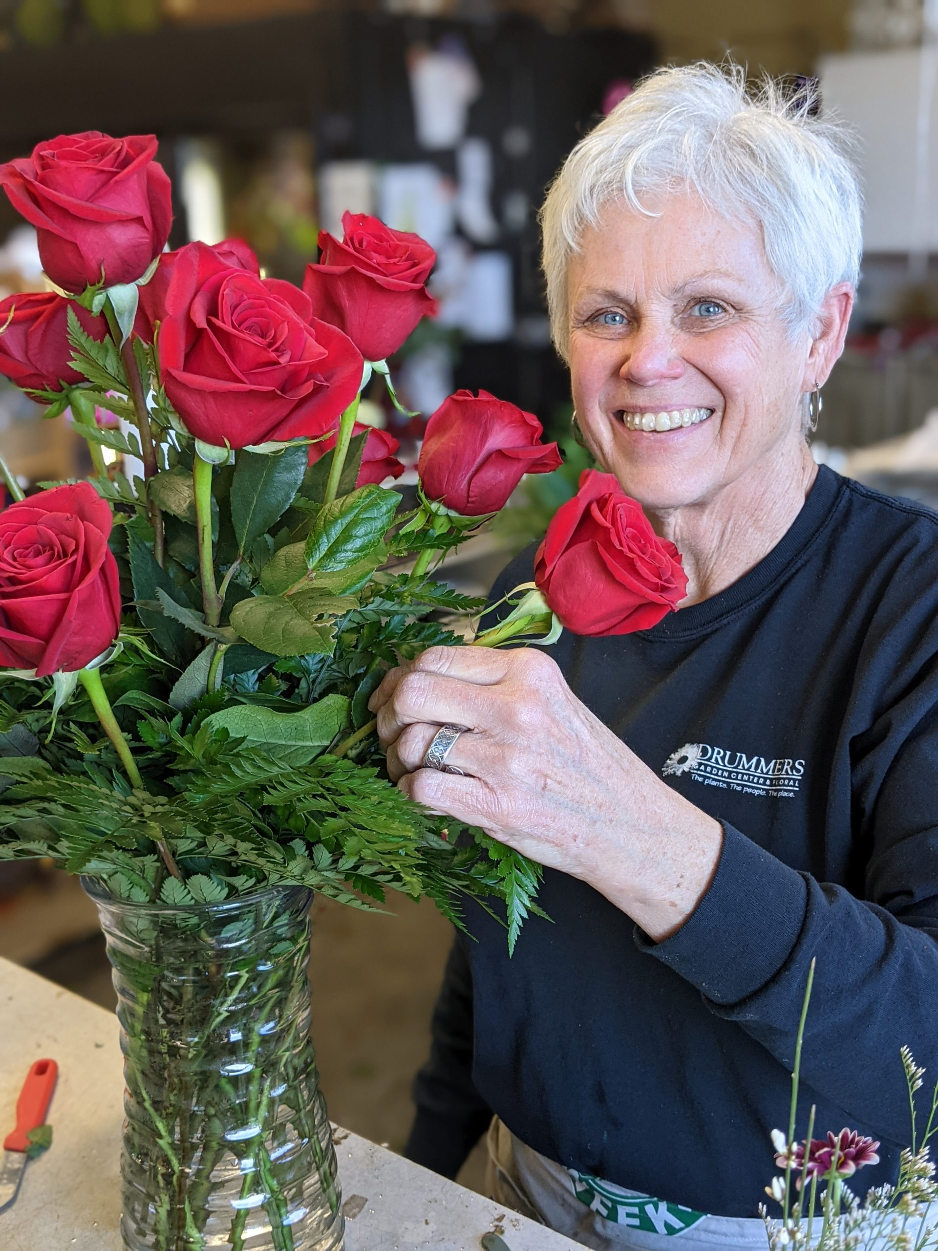 Nell florist making rose bouquet